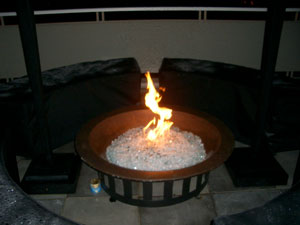 patio fire bowl with burning glass