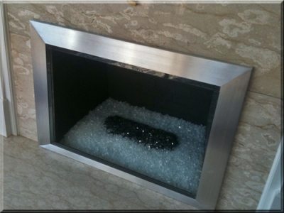 Custom Fireplace Surrounds. Custom metal frames for fireplaces.